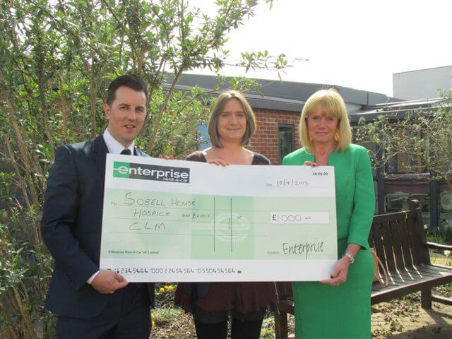 Enterprise presents cheque to Sobell House