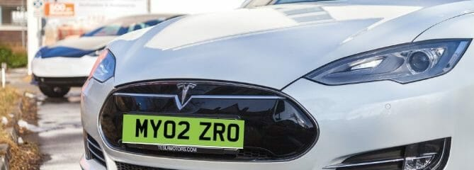 mock up of green number plate on a Tesla