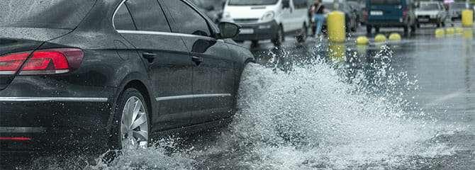 car driving through a flood